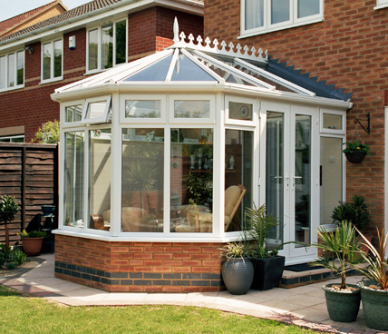 Victorian Conservatory with patio across garden