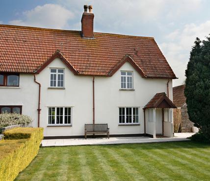 Double Glazing windows on house across garden