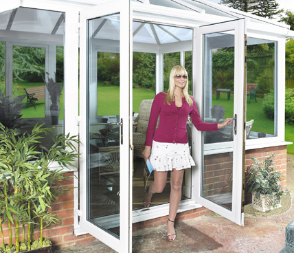 Lady walking our of French door