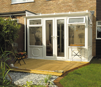 Lean To Conservatory with decking garden view